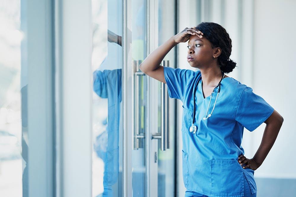 Female nurse or doctor stressed at work