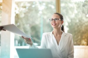 positive-businesswoman-doing-paperwork-in-office-3756678-1000